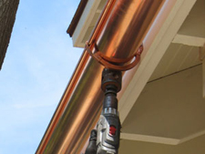 drilling holes at downspout locations